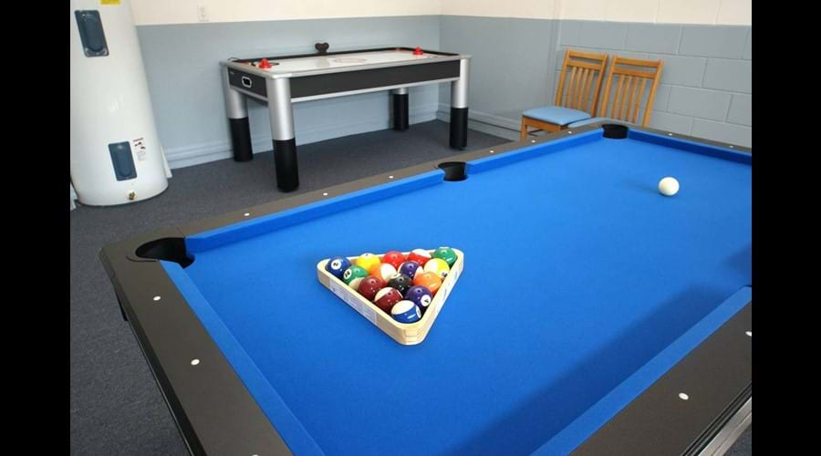 Games room with 7' pool table; Air-Hockey & Darts