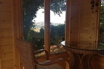 Our garden summerhouse - a log cabin equipped with lovely conservatory furniture