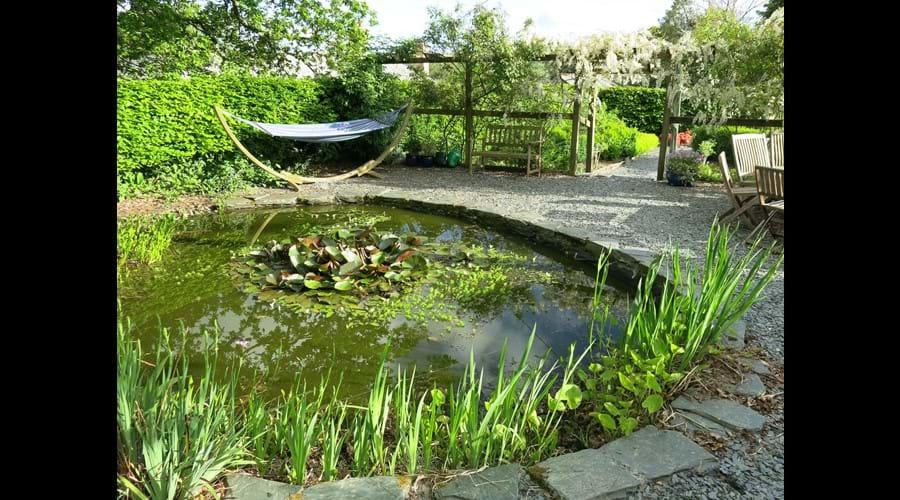 Enclosed garden with fishpond and hammock (lovely spot for a snooze or some outdoor dining)