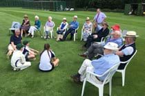 Initiative Members taliking with the Chairman of Saffron Walden Cricket Club, David Barrs, and three of the junior members on 22 June 2019