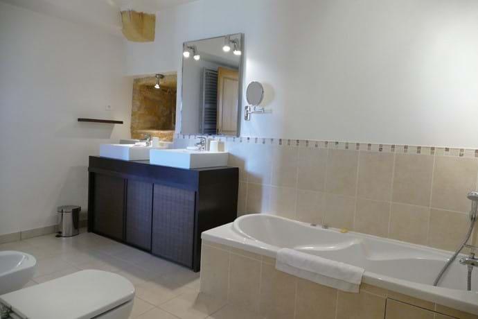 En suite for Bedroom One with spa bath, shower, double vanity, wc & bidet