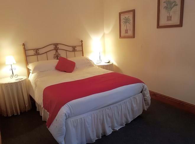 A ground floor bedroom in La Roseraie