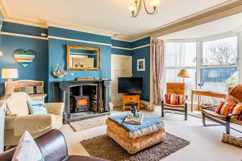 The cosy blue lounge complete with wood burner and beautiful views. (south facing)