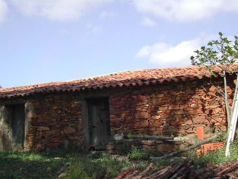 front of smaller house