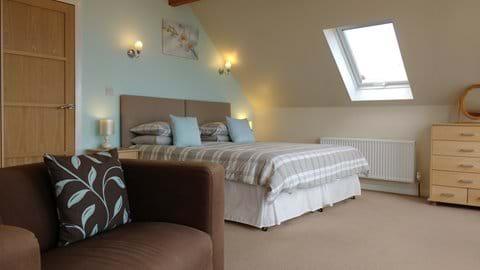 Spacious master bedroom with sea views
