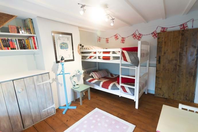 Anothe view of the Bunk Room at Barnfield - complete with childrens and teenage books