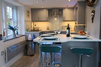 Fully fitted kitchen with dining