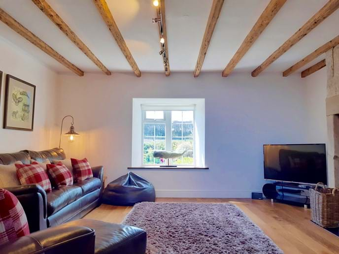 The original wooden beams add to the cottage
