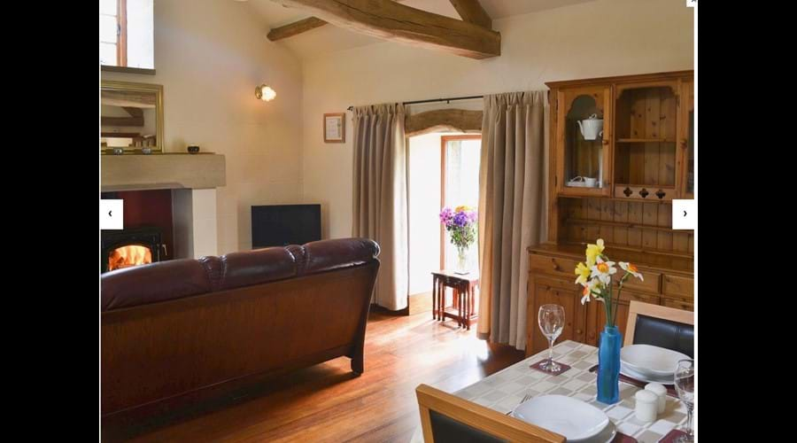 Open plan accommodation with beautiful wooden floor and vaulted beam ceilings