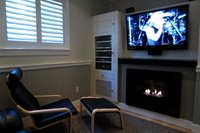 Cozy entertainment room with satellite HDTV and gas fireplace