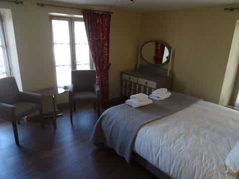 2nd floor bedroom with seating and views over the main square