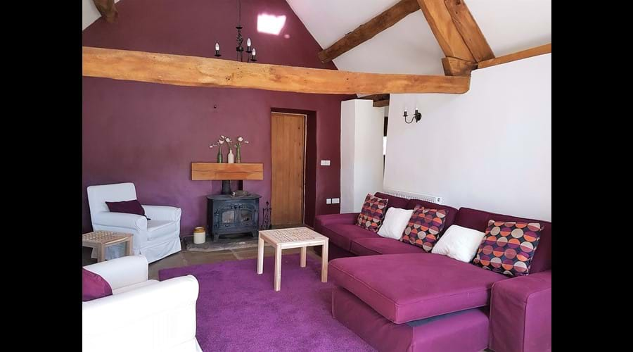 Spacious living area with woodburning stove, 32 inch flat screen TV and bags of character.