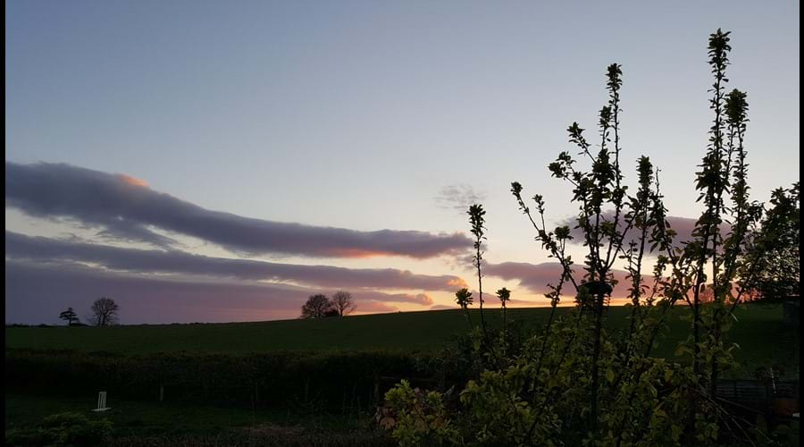 Watch the sun set beautifully over the surrounding countryside.