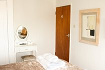 Top floor front bedroom has a dressing table to sit at.  So who IS the fairest one of all?
