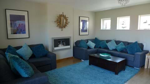 Large sitting room with lots of comfortable seating