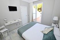 Master bedroom doors to upper sun terrace