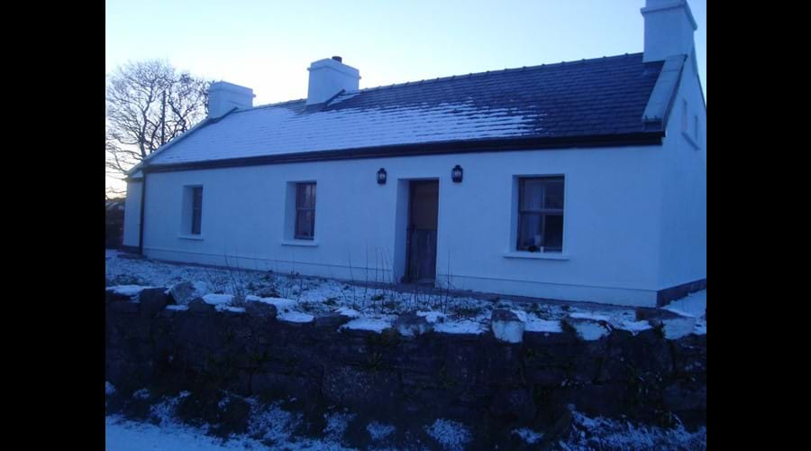 Front view of the cottage in the snow