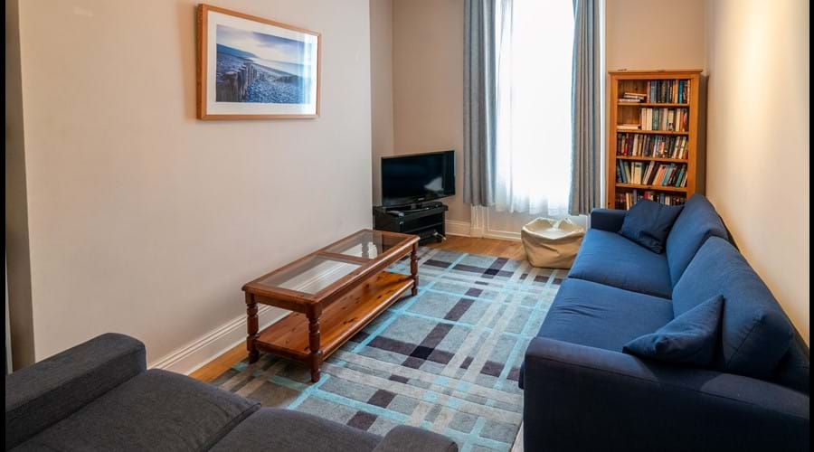 Snug sitting room with 2 sofas, TV, PS2, assorted PS2 games, small library of books, boardgames and DVDs
