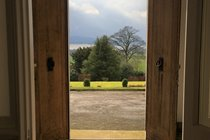 Looking out the front door, over the garden and the tress, to Loch Leven
