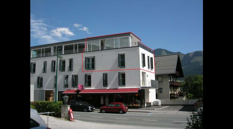 Front of building - apartment outlined in red.  Living area on top floor with amazing views