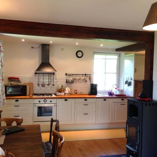 Kitchen with dining area and stove (ground floor)