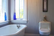 The spacious main bathroom on the upper level was completely remodeled and features a deep re-glazed bath tub
