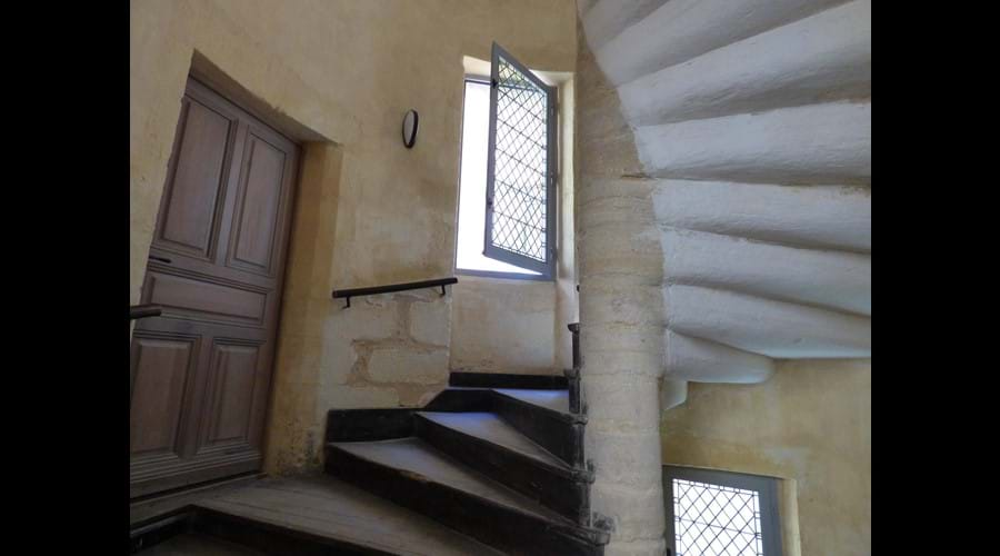 The spiral staircase leads to the apartment