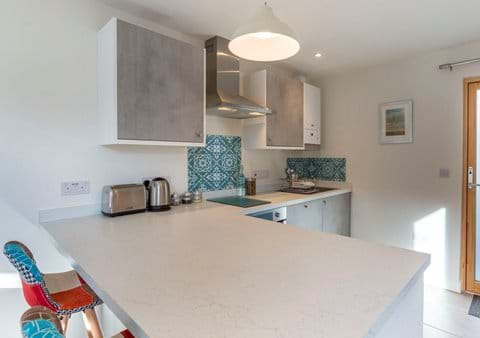 Breakfast bar and fully fitted kitchen for long lazy breakfasts and cozy nights in