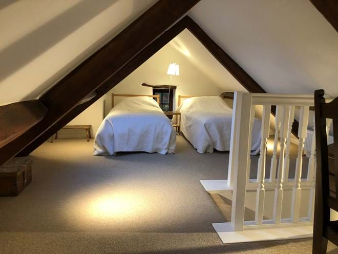 Galleried loft room with two single beds