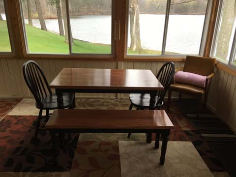A second table is on the porch for eating or playing games or just sitting at and enjoying the view or the company.