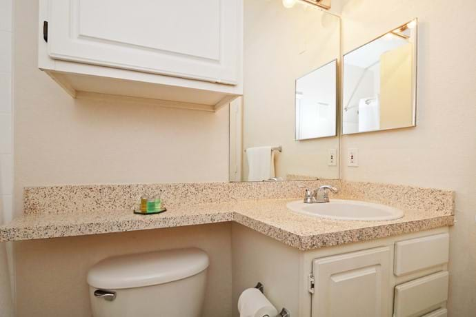 Bathroom with shower over bathtub - access from Bed 2 as well as from hallway