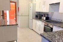 Kitchen with large fridge freezer