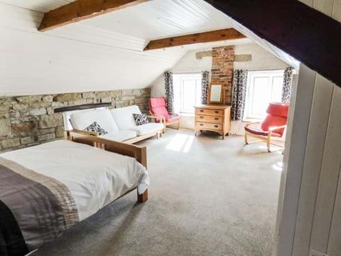 The huge master bedroom with a view across to the Pele Tower opposite