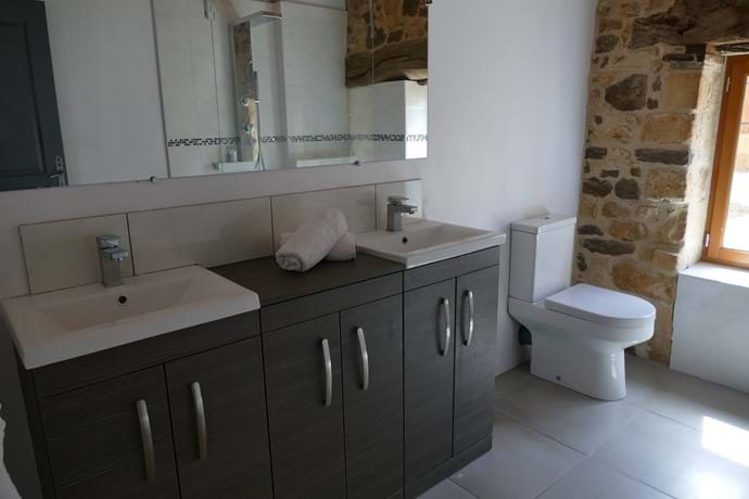 En suite for Bedroom One with its double vanity unit