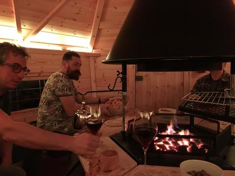 Guests enjoying the Scandinavian style BBQ cabin