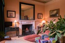 A cheery woodfire in the sitting room.