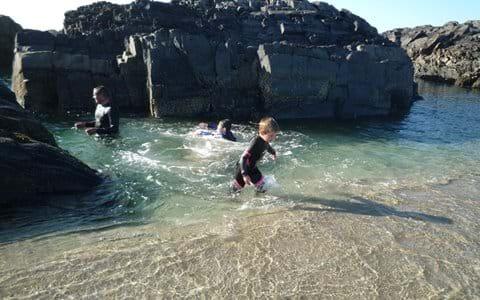 Swimming in the rock-pools at Saligo