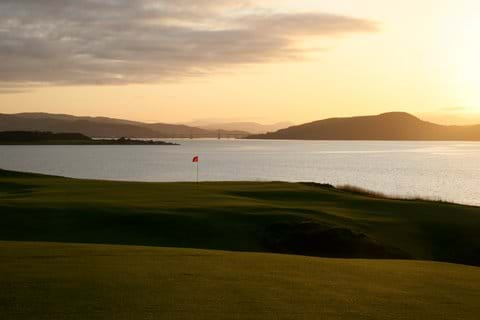 Castle Stuart 18th hole at sunset