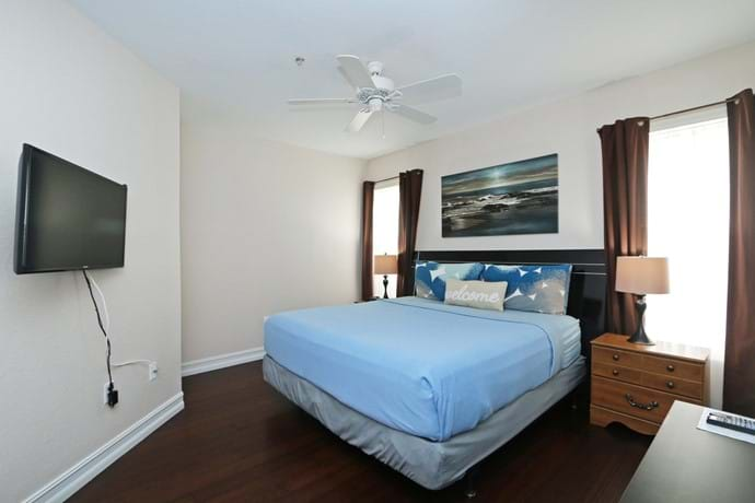 Master Bedroom with King Bed and walk in closet, en-suite bathroom and large TV