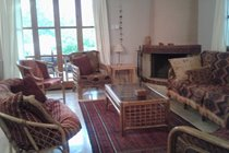 Sitting room with french windows to the terrace