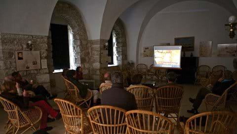 Lunch group enjoy a film in the Salle de Sion