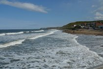 View towards Whitby from Sandsend as tide comes in