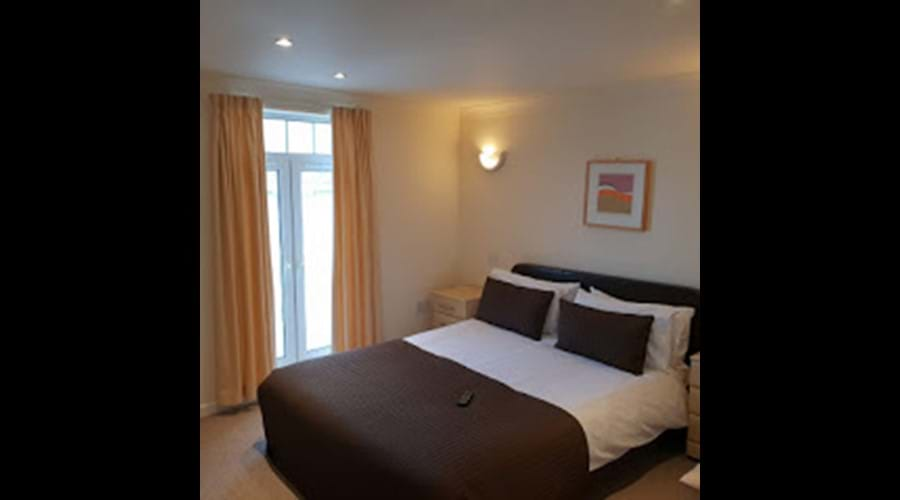 Master Bedroom with King size Bed and Smart tv. AG34