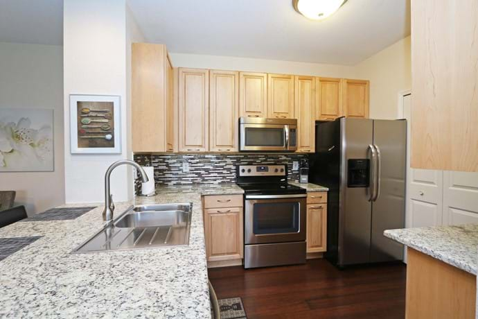 New Kitchen at 13-102 our 4 bedroom condo with solid maple wood cabinets & granite worktops