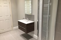Groundfloor shower room with vanity unit and washbasin