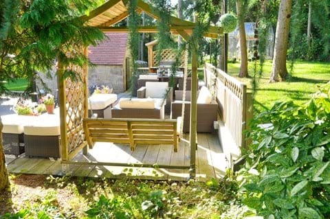 secluded outdoor seating area in beautiful mature gardens
