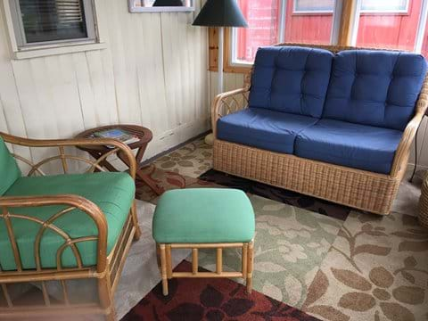 Glider love seat and chair with ottoman.
