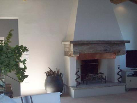 The fireplace in the top sitting room