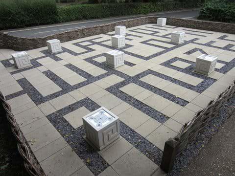 """The child-friendly maze at Swan Meadow which reads """"Saffron Walden Amazes"""""""
