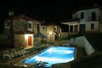 The pool looks pretty at night at our family chalet accommodation